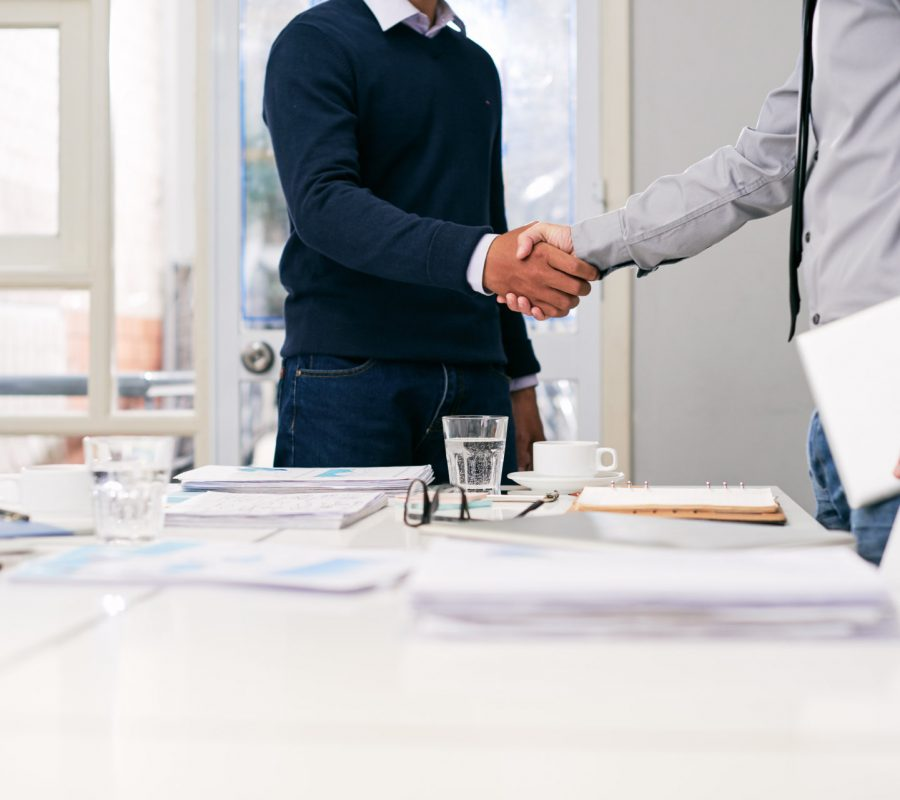 Cropped image of businessmen shaking hands before meeting